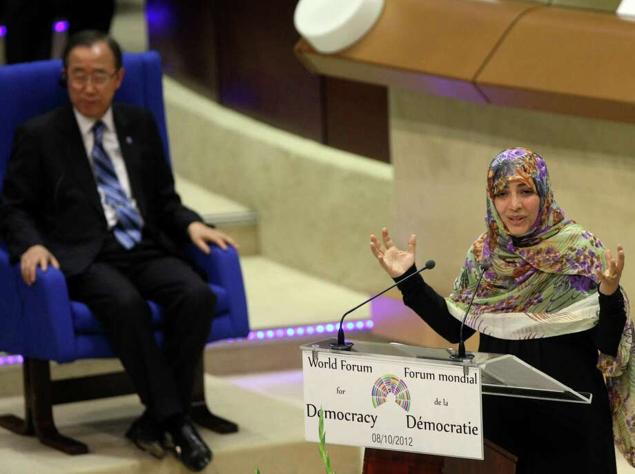 2011 Nobel Peace Prize winner Tawakkol Karman, of Yemen, delivers her speech during the World Forum for Democracy, Monday, Oct. 8, at the Council of Europe in Strasbourg, eastern France. Yemeni activist and journalist Tawakkol Karman, who galvanized Yemeni support for the Arab Spring, a is also a cofounder of the human rights group Women Journalists Without Chains and a senior member of the opposition political party Al-Islah.  Photo: Christian Lutz, Associated Press / AP