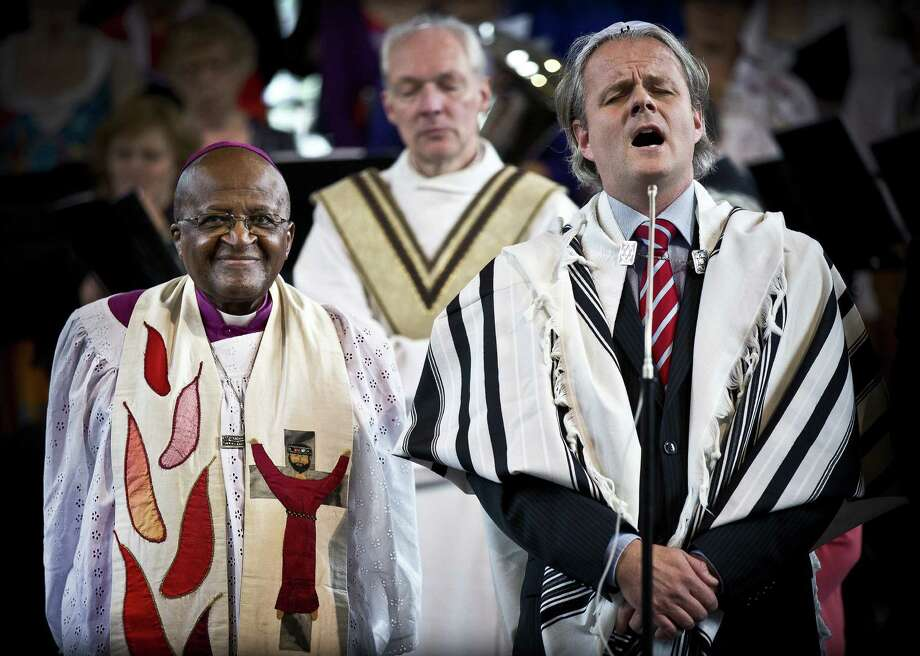 South African Archbishop Desmond Tutu (left) attended an interfaith service at a church in Deventer, eastern Netherlands, on September 22. He won  the 1984 Nobel Peace Prize.  Photo: ILVY NJIOKIKTJIEN, AFP/Getty Images / AFP
