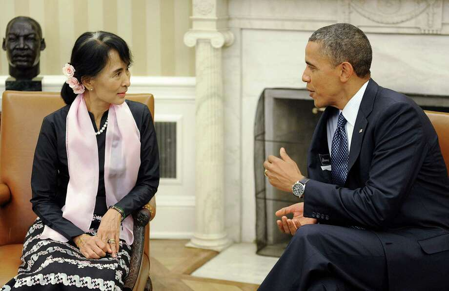 1991 Nobel Peace Prize winner Aung San Suu Kyi, a pro-democracy leader in Myanmar, met with U.S. President and 2009 peace prize winner Barack Obama in the Oval Office of the White House on Wednesday, Sept. 19. Photo: Olivier Douliery, McClatchy-Tribune News Service / Abaca Press