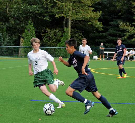 Junior Wyatt Cook, right, pushes the ball up the pitch in Green Farms Academy's 8-2 win over Chase Collegiate on Oct. 6. Photo: Contributed Photo