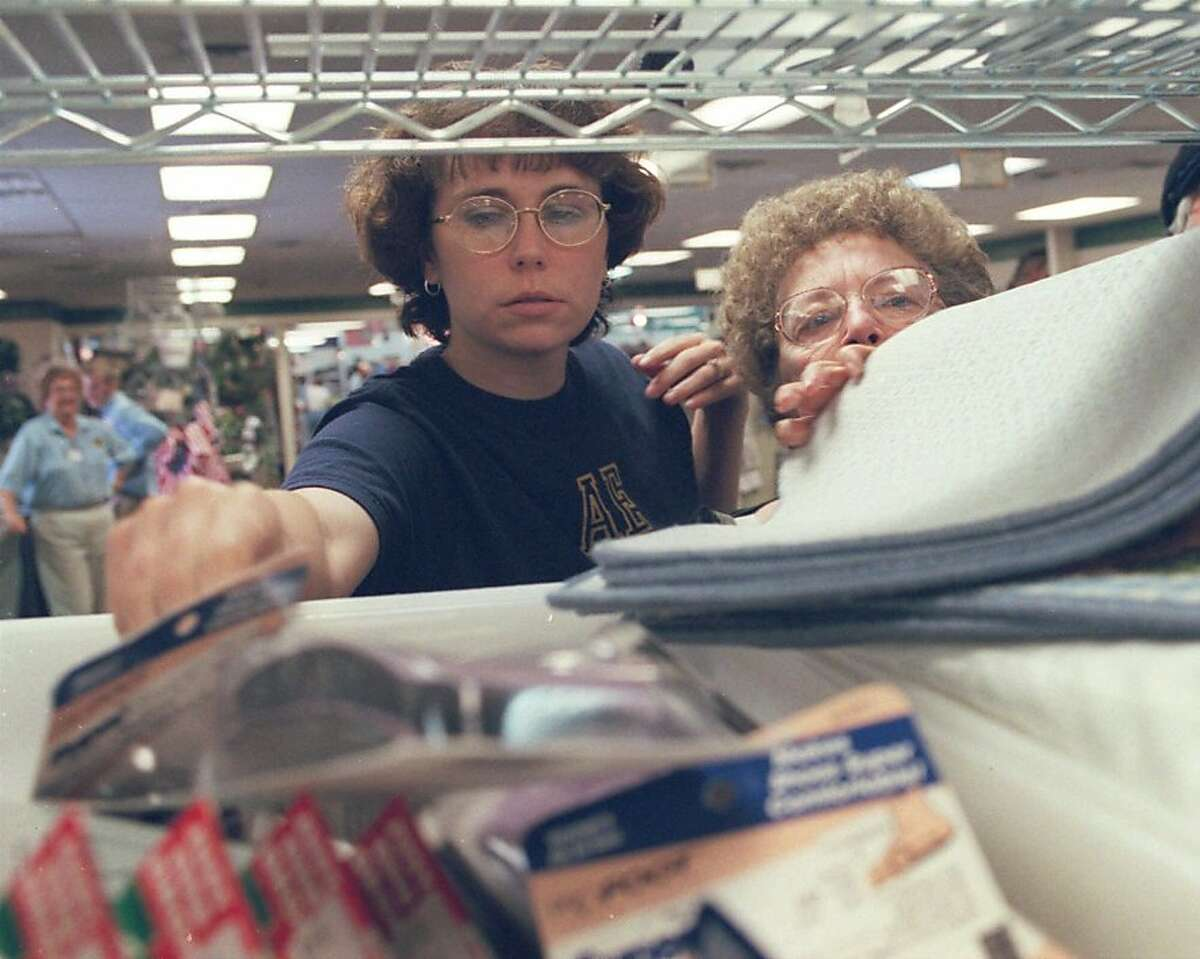 Shoppers look through merchandise at the Unclaimed Baggage Center in Scottsboro, Ala., Sept 8, 2000. The Unclaimed Baggage Center, which opened in 1970 and stretches an entire city block, has an agreement with most U.S airlines to resell unclaimed luggage and its contents for half the original value. The country's largest lost-baggage retailer sells everything from pearls and diamond-studded cuff links to boxer shorts and half-used cans of shaving cream.