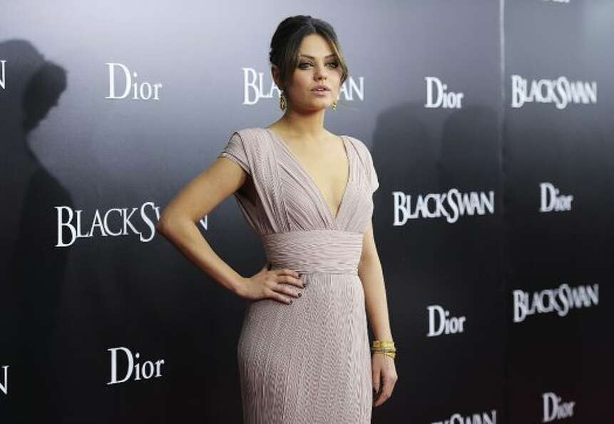 "Actress Mila Kunis attends the New York Premiere of ""Black Swan"" at Ziegfeld Theatre on No"