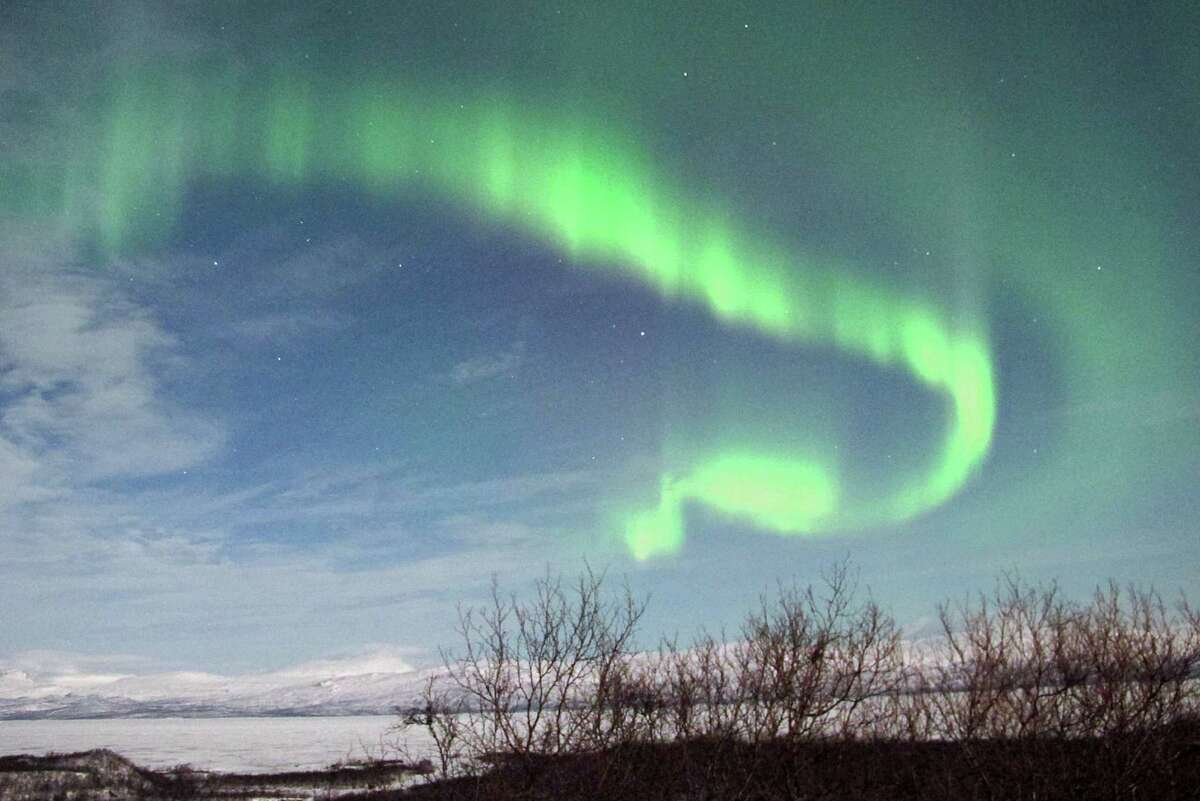 A picture taken late on March 7, 2012, of northern lights in Abisko, Swedish Lapland.