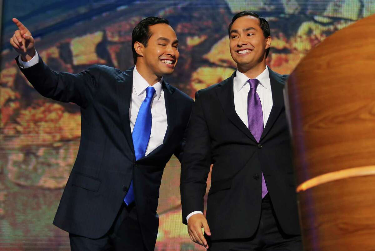 CHARLOTTE, NC - SEPTEMBER 04: State Rep. Joaquin Castro (D-TX)(R) waves with his brother San Antonio Mayor Julian Castro during day one of the Democratic National Convention at Time Warner Cable Arena on September 4, 2012 in Charlotte, North Carolina. The DNC that will run through September 7, will nominate U.S. President Barack Obama as the Democratic presidential candidate.