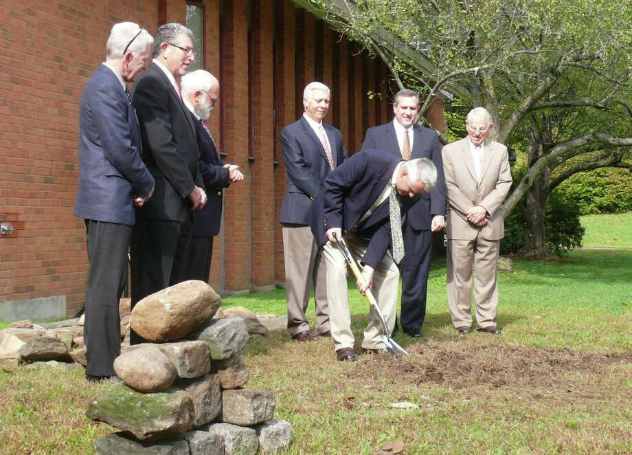 Craig Samuelson, with shovel, is joined in the groundbreaking ceremony for Black Rock Congregational Church Monday by, from left, John Tocci, of Tocci Building Companies, architect George Wiles, Alan Dodd, Board of Elders chairman, Executive Director Ken Brix, Senior Pastor Stephen Treash and Pastor Emeritus Stanley Allaby. Photo: Genevieve Reilly / Fairfield Citizen