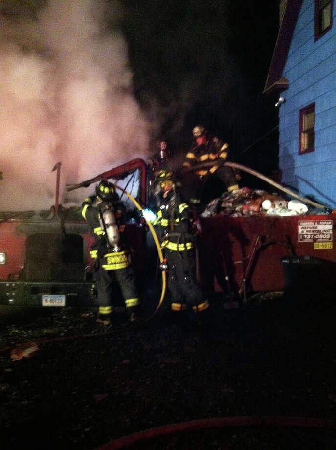 Fire in a recycling truck at 37 Brewster Street, Fairfield on Oct. 8, 2012 Photo: Fairifeld Fire Department