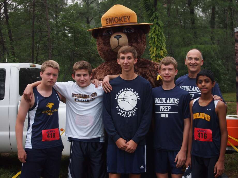 Quinn Hayes, Braden Hodges, Douglas Begin, Garrett Groppell, Coach Doug Begin and Suraj Sudharsan are part of The Woodlands Preparatory School cross country team that recently ran the CASA Fun Run.