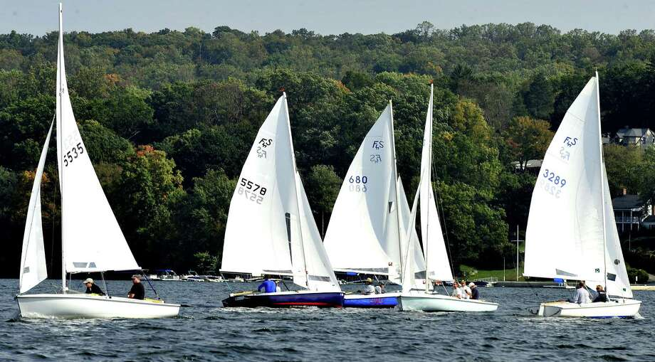 Competitors race Flying Scot sailboats in the Roger Punzi Memorial Regatta, sponsored by the Candlewood Yacht Club, in New Fairfield Saturday, Oct. 6, 2012. Roger Punzi was a member of The club and a sailor of the Flying Scot, a fast 19-foot sailboat. Photo: Michael Duffy