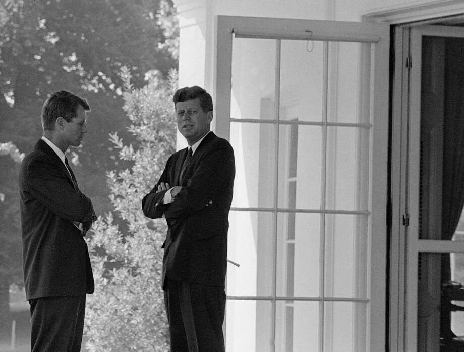 U.S. President John F. Kennedy, right, confers with his brother Attorney General Robert F. Kennedy at the White House in Washington, D.C., on Oct. 1, 1962 during the buildup of military tensions between the U.S. and the Soviet Union that became Cuban missile crisis later that month. Photo: AP / 1962 AP