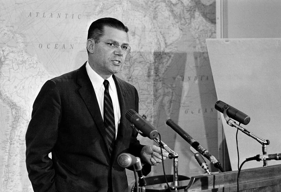 Secretary of Defense Robert S. McNamara, seen at a news conference at the Pentagon, Oct. 23, 1962, announced he had ordered all Navy and Marine Corps enlistments and duty tours extended for up to one year to support the arms blockade of Cuba.  He said hardship cases would be considered individually.  (AP Photo/Harvey Georges) Photo: Harvey Georges, AP / 1962 AP