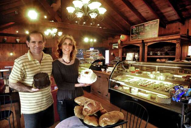 James and Layla Nejati hold cakes in their Brookfield business, Layla's Bakery, Sunday, Oct. 7, 2012. Photo: Michael Duffy