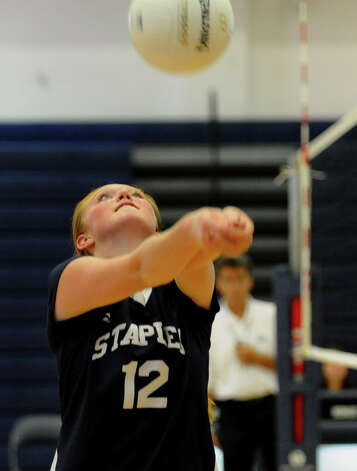 Staples #12 Frankie Lynch bumps the ball, during volleyball scrimmage action against Weston in Weston, Conn. on Thursday September 6, 2012. Photo: Christian Abraham / Connecticut Post
