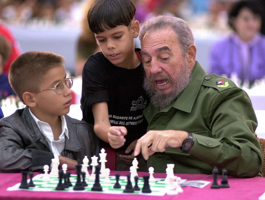 In his later years, Fidel moved on to other games, like beating children at chess. Photo: CRISTOBAL HERRERA, ASSOCIATED PRESS / AP2002