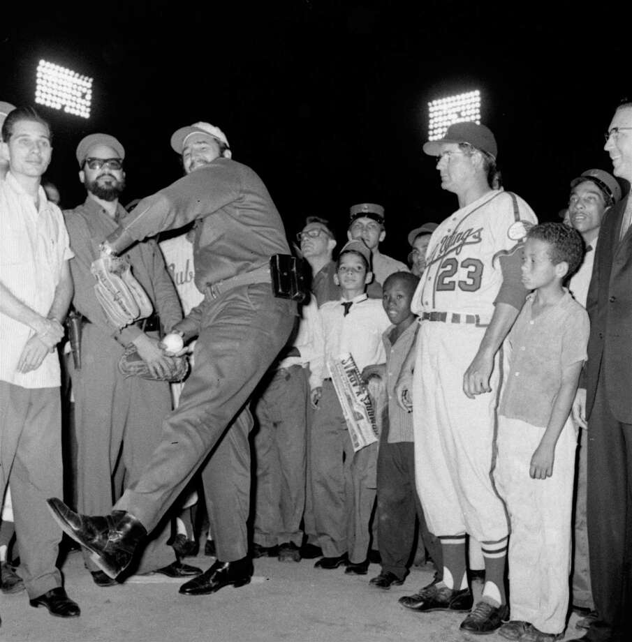 Fidel even played ball with the Americans, here he throws out the first pitch at a game featuring the visiting Rochester Red Wings. Photo: Anonymous, ASSOCIATED PRESS / AP1960