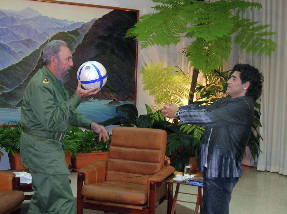 "But Fidel was also a fan of ""the beautiful game."" Here he fools around with coke-head-era Maradona in 2005. Photo: Anonymous, ASSOCIATED PRESS / AP2005"