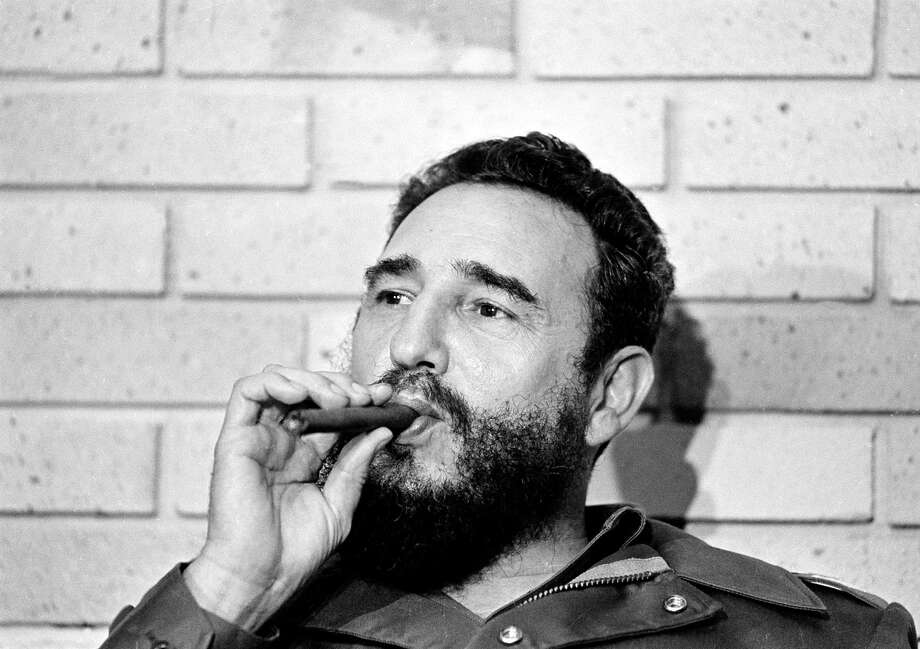 Fidel Castro, Prime Minister of Cuba, smokes a cigar during his meeting with two U.S. senators, the first to visit Castro's Cuba, in Havana, Cuba, Sept. 29, 1974.  (AP Photo) Photo: ASSOCIATED PRESS / AP1974