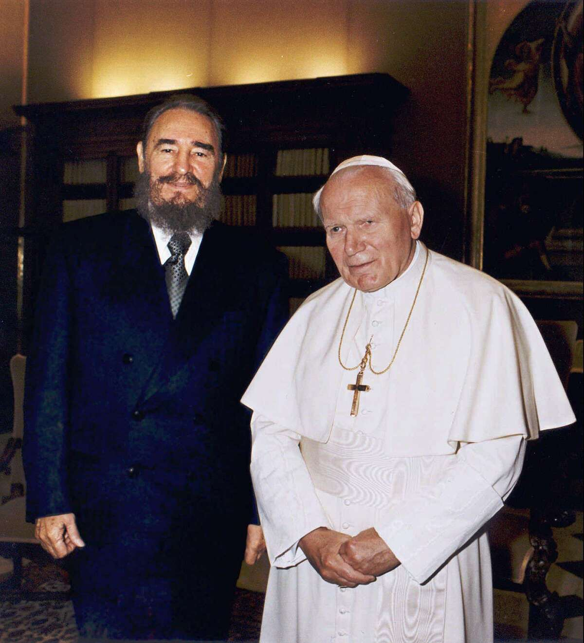 Cuban leader Fidel Castro and Pope John Paul II during their historic meeting at the Vatican Tuesday, November 19, 1996. Following Castro's invitation to visit Cuba, the only Latin American country that the 76-year-old pope has yet to visit, the Pope will leave for Cuba Wednesday, January 21 1998, for a five-day official trip. (AP Photo/Arturo Mari)