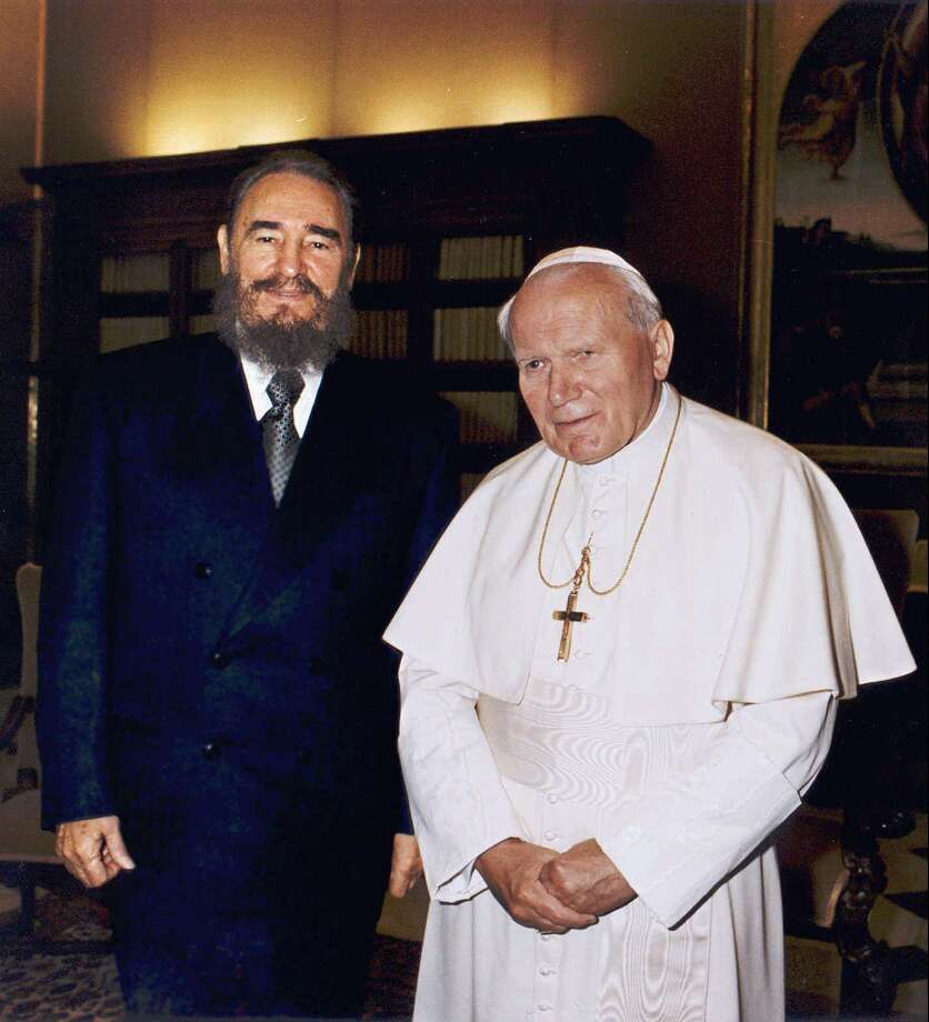 Cuban leader Fidel Castro  and Pope John Paul II during their historic meeting at the Vatican Tuesday, November 19, 1996.  Following Castro's invitation to visit Cuba, the only Latin American country that the 76-year-old pope has yet to visit,  the Pope will leave for  Cuba Wednesday, January 21 1998, for a five-day official trip. (AP Photo/Arturo Mari) Photo: ARTURO MARI, ASSOCIATED PRESS / AP1996