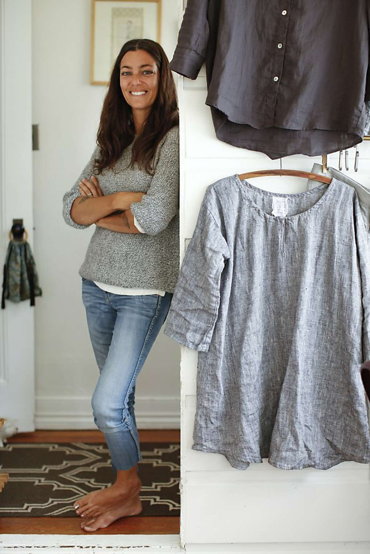 Designer Jess Brown, seen on Thursday, Oct. 4, 2012 in her Petaluma, Calif., home studio, has introduced a women's clothing collection as part of her expanding lifestyle brand.