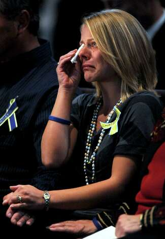 Tiffany Young-Hartley, widow of David Hartley, cries as she listens to her sister share stories about her husband during his memorial service on Sunday, Nov. 7, 2010, at Timberline Church in Fort Collins, Colo. Tiffany Hartley says her husband was shot on the Mexican side of Falcon Lake on Sept. 30. Authorities have not yet found Hartley's body. Photo: Dawn Madura, AP / The Fort Collins Coloradoan