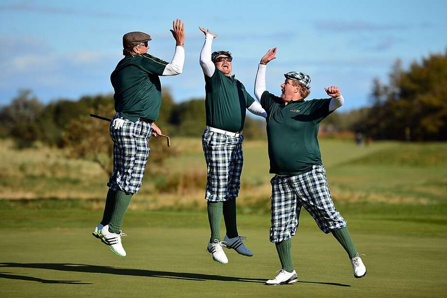 I broke 100!Golfers dressed in 1930s period costumes leap for an