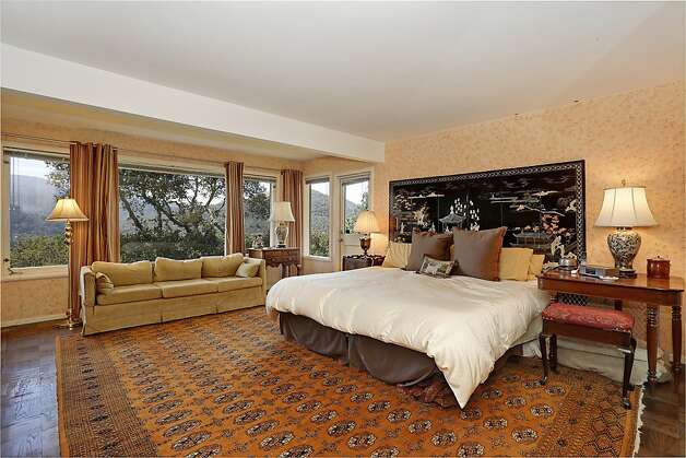 A master suite has hardwood floors, a sitting area and stunning views. Photo: Frank Howard Allen Realty