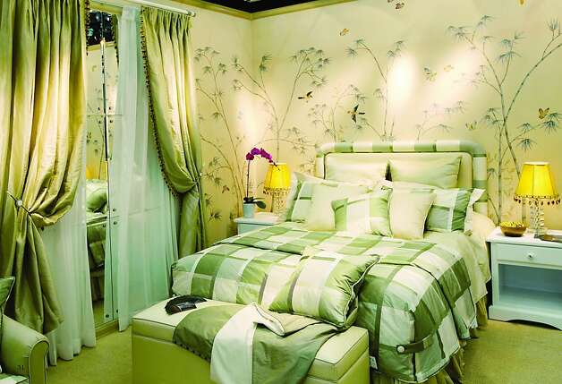 The shimmering silk in this room is a recurring theme, from the wallcoverings to the curtains to the bed linens. Photo: B. Mori & Co