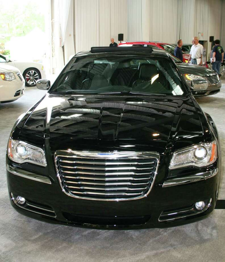 A Chrysler 300C on display at the state fair flaunts a menacing street look.
