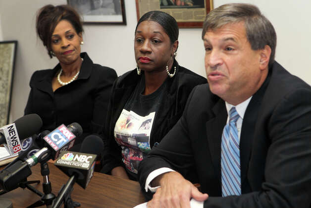 Attorneys,  Richard Altschuler , right,  and Sandra Moore, left, hold a press conference to announce the filing of law suit on behalf of Olamae Hardy, center,  on Monday, October 8, 2012 in West Haven Conn.  Hardy is the mother of former Sacred Heart basketball player Chauncey Hardy, who was beaten to death in Romania last year while playing professional basketball. Photo: BK Angeletti, B.K. Angeletti / Connecticut Post freelance B.K. Angeletti