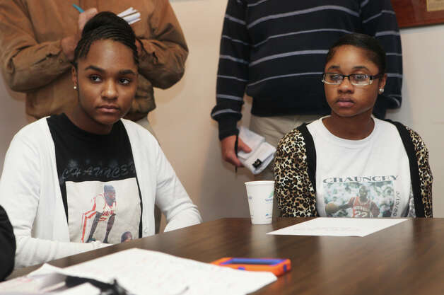 Sisters, Jada Kansey, 15, left, and Onnalise Hardy, 19, attend a press conference as attorneys announce the filing of law suit on behalf of their brother, Chauncey Hardy on Monday, October 8, 2012, in West Haven Conn.  Chauncey Hardy, a former Sacred Heart basketball player, who was beaten to death in Romania last year while playing professional basketball. Photo: BK Angeletti, B.K. Angeletti / Connecticut Post freelance B.K. Angeletti