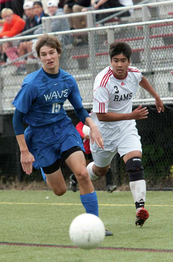 Darien high school's Nick Vilter and New Canaan high school's Justin Pertierra battle for the ball in a boys soccer game held at New Canaan high school, New Canaan, CT Monday October 8th, 2012. Photo: Mark Conrad / Stamford Advocate Freelance