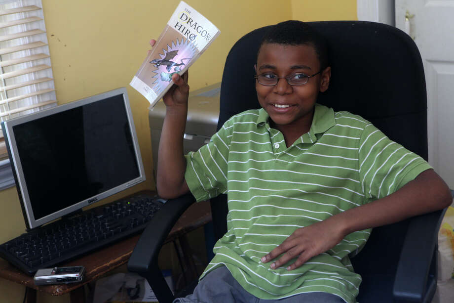 Aaron Thomas Russell, 12, of Bridgeport, Conn, talks about his published book in his home office on Monday, October 8, 2012. Photo: Unknown, B.K. Angeletti / Connecticut Post freelance B.K. Angeletti