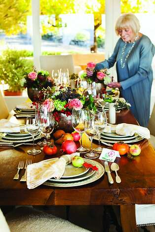 Margrit Mondavi shares photos of her elegant tables set with hand-painted menus and place cards, simple, straightforward recipes, including her late husband's favorite dish, and watercolors in her most recent book. Photo: Courtesy Of The Robert Mondavi W, Special To The Chronicle