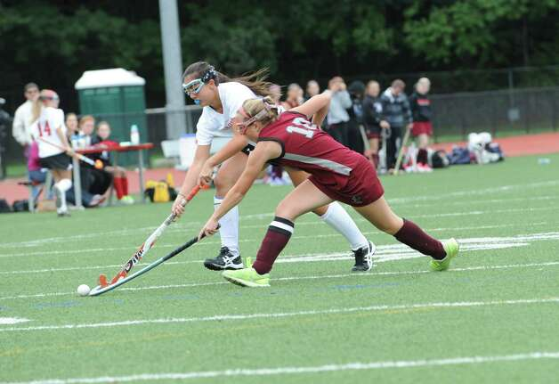 Greenwich High School's # 18 Sarah Stinebaugh fights with Pomperaug High School's #10 Mackenzie Vaughan in a game of field hockey in Greenwich, Monday, Oct. 8, 2012. Greenwich won 5 to 1. Photo: Helen Neafsey / Greenwich Time