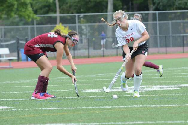 Pomperaug High School's # 14 Julianna Palumbo fights with Greenwich High School's #28 Sarah Rider in a game of field hockey in Greenwich, Monday, Oct. 8, 2012. Greenwich won 5 to 1. Photo: Helen Neafsey / Greenwich Time