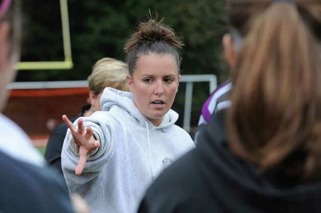 Pomperaug High School's field hockey coach Ally Orrico speaks to the team at the Greenwich High School's game of field hockey in Greenwich, Monday, Oct. 8, 2012. Photo: Helen Neafsey / Greenwich Time