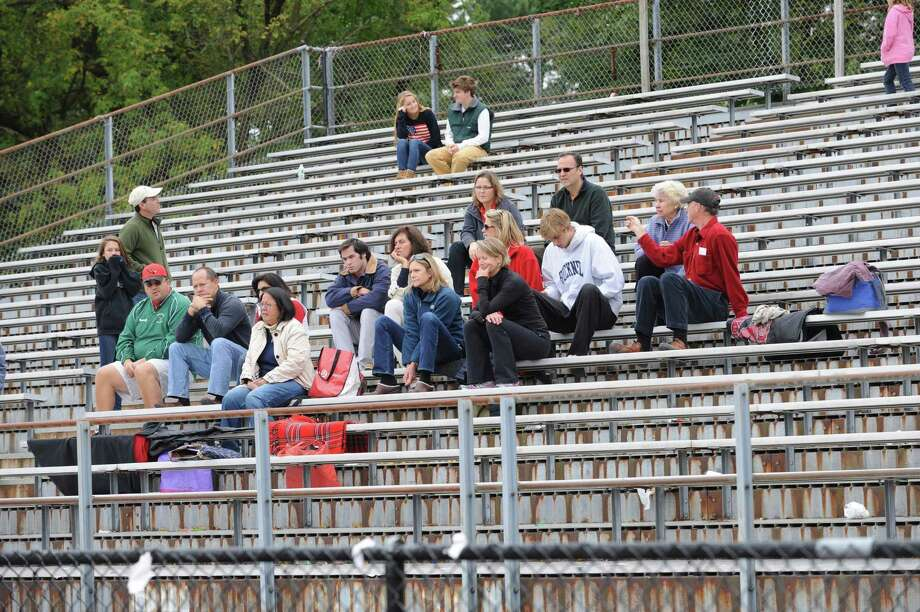 People came to see the Pomperaug High School and Greenwich High School in a game of field hockey in Greenwich, Monday, Oct. 8, 2012. Photo: Helen Neafsey / Greenwich Time