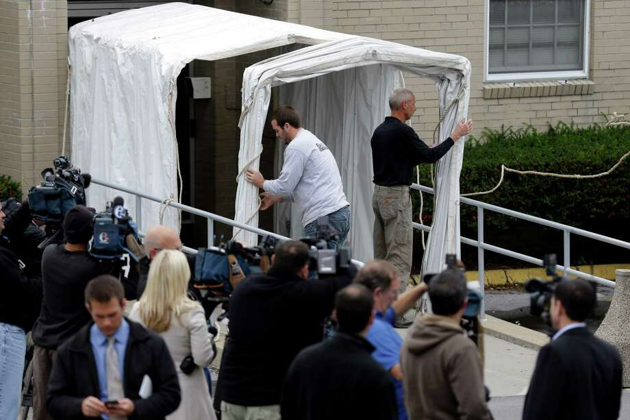 A privacy tunnel is erected at the Centre County Courthouse Monday, Oct. 8, 2012, in Bellefonte, Pa. Former Penn State University assistant football coach Jerry Sandusky is scheduled to be sentenced Tuesday for sexually abusing 10 boys in a scandal that rocked the university and brought down coach Joe Paterno. (AP Photo/Matt Rourke) Photo: Matt Rourke, STF / AP