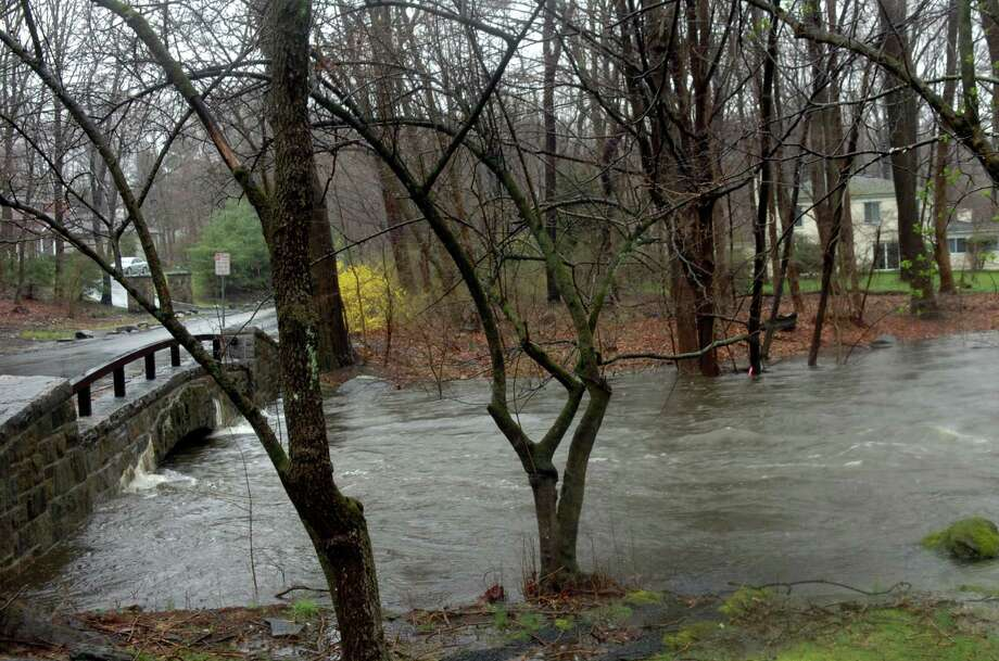 The Byram River was high at Riversville Road during the rain storm March 30, 2010. Photo: Helen Neafsey, ST / Greenwich Time