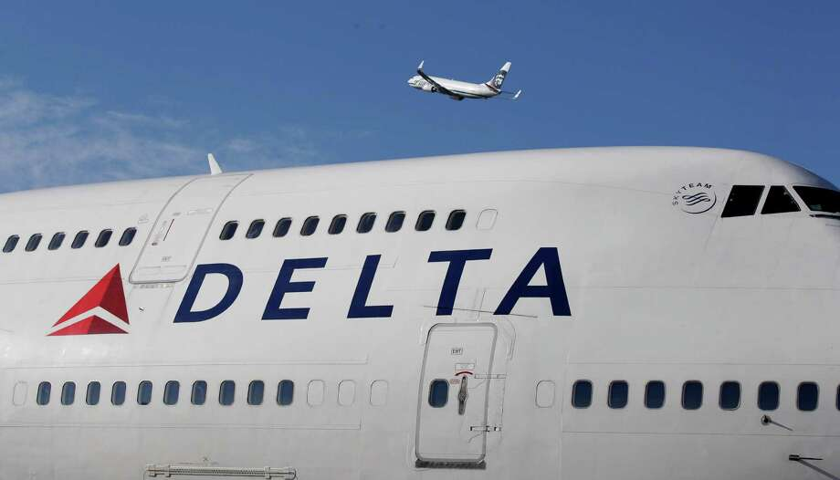 An Alaska Airlines Boeing 737 takes off above a Delta Air Lines 747-400 on Monday, Oct. 8, 2012, at Seattle-Tacoma International Airport. While Delta and Alaska are partners, they also are competing on an increasing number of Seattle routes. Click on for details. Photo: AP