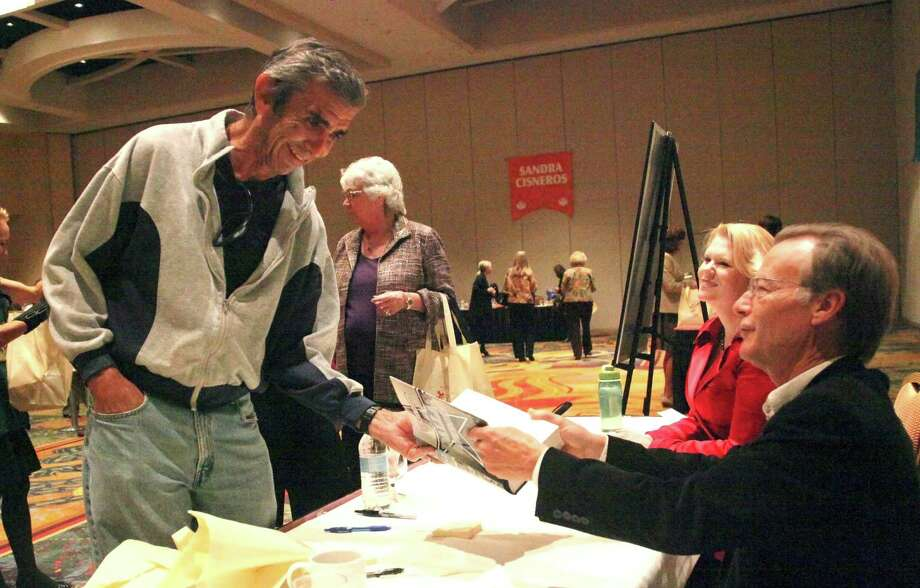 Author Joe Nick Patoski signs a book for Hector David Ponce at the Book & Author Signing on October 8, 2012 at Marriott Rivercenter Hotel. Photo: Juanito M.Garza, San Antonio Express-News / San Antonio Express-News