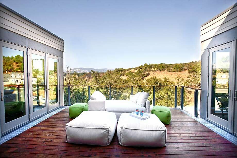 A view to behold: From the home's front balcony, hills dotted with vegetation roll to the horizon's edge. Photo: Sibylla Herbrich
