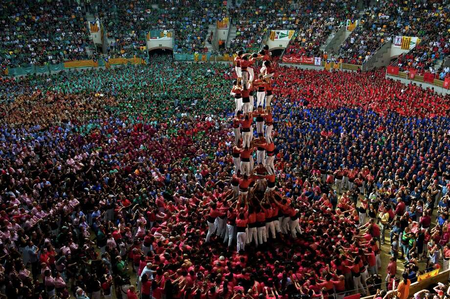 Members of the Colla 'Vella de Valls' climb up as they construct a human tower during the 24th Tarragona Castells Competition on October 7, 2012 in Tarragona, Spain. Photo: David Ramos, Getty Images / 2012 Getty Images