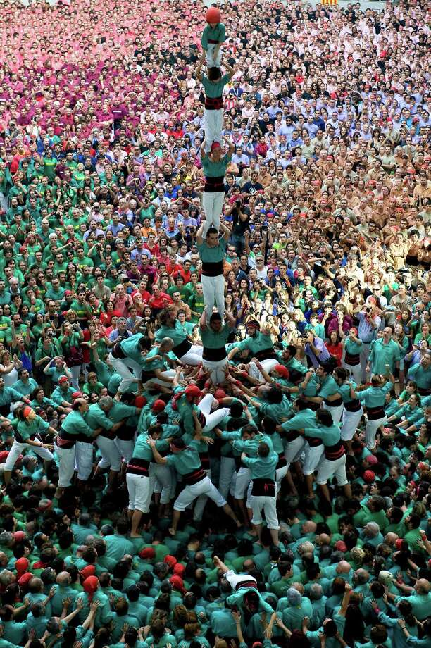 Members of the Colla 'Castellers de Vilafranca' climb up as they construct a human tower during the 24th Tarragona Castells Competition on October 7, 2012 in Tarragona, Spain. Photo: David Ramos, Getty Images / 2012 Getty Images