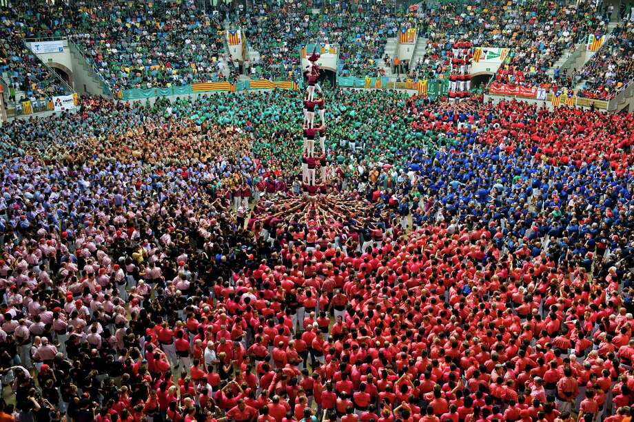 Members of the Colla 'Castellers de Lleida' climb up as they construct a human tower during the 24th Tarragona Castells Competition on October 7, 2012 in Tarragona, Spain. Photo: David Ramos, Getty Images / 2012 Getty Images