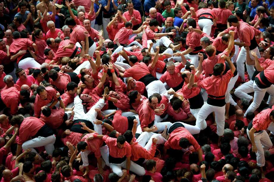 Members of the Colla 'Vella de Valls' celebrate after building a human tower during the 24th Tarragona Castells Competition on October 7, 2012 in Tarragona, Spain. Photo: David Ramos, Getty Images / 2012 Getty Images