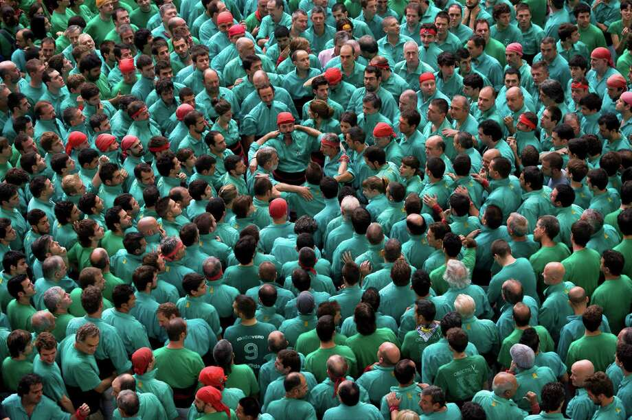Members of the Colla 'Castellers de Vilafranca' start a construction of a human tower during the 24th Tarragona Castells Competition on October 7, 2012 in Tarragona, Spain. Photo: David Ramos, Getty Images / 2012 Getty Images