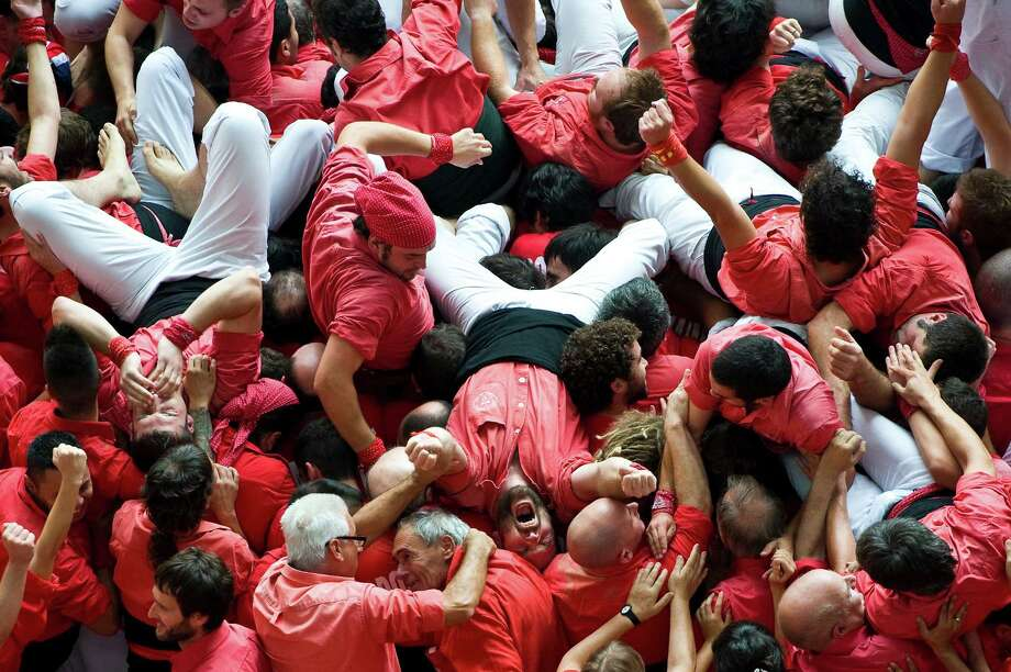 Members of the Colla 'Jove de Valls' celebrate after building a human tower during the 24th Tarragona Castells Competition on October 7, 2012 in Tarragona, Spain. Photo: David Ramos, Getty Images / 2012 Getty Images