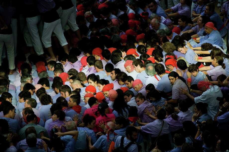 Members of the Colla 'Jove de Tarragona' start a construction of a human tower during the 24th Tarragona Castells Competition on October 7, 2012 in Tarragona, Spain. Photo: David Ramos, Getty Images / 2012 Getty Images
