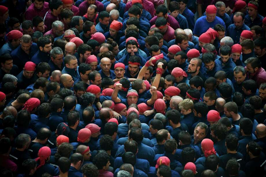 Members of the Colla 'Capgrossos de Mataro' start a construction of a human tower during the 24th Tarragona Castells Competition on October 7, 2012 in Tarragona, Spain. Photo: David Ramos, Getty Images / 2012 Getty Images